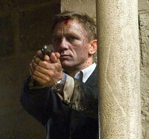 Bloodied 007 with gun